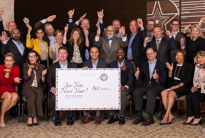 "Board of Directors posing with ""See you next year"" sign"