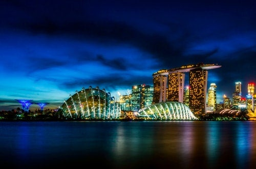 Landscape of Singapore at night as seen from the water